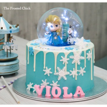 Drip cake with Globe and Frozen Elsa and Olaf toy toppers